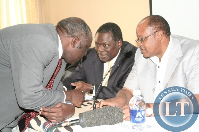 Barotse Royal Establishment (BRE) Induna Kalonga (l) confers with Patents and Companies Registration Agency (PACRA) Board Chairman Wilson Nyirenda SC (c) as Western Province PS Augustine Seyuba (r) listens on during Ministry of Commerce, Trade and Industry Stakeholders Workshop at Country Lodge in Mongu District, Western Province