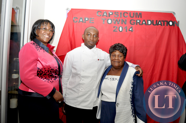 FILE: Late President Michael Sata's son Mwango (c) with  mother Dr Christine Kaseba and grand mother Loyce Kaseba (r) after his Chef management programme graduation ceremony at Capsicum Cape Town Campus in South Africa on June 11, 2014 -Picture by THOMAS NSAMA
