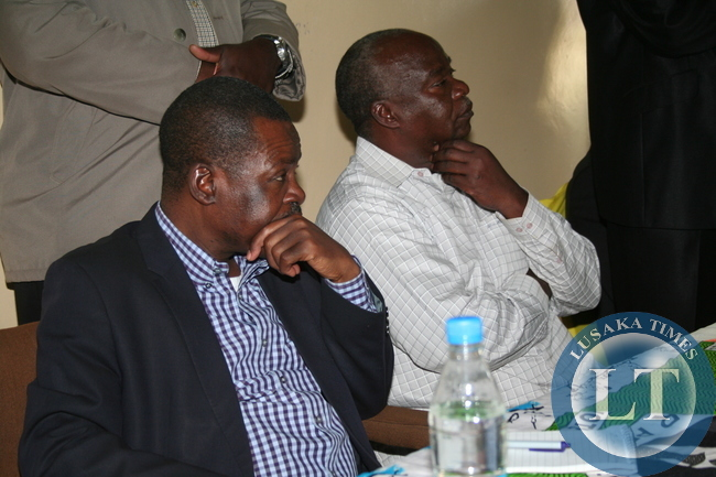 PATRIOTIC Front Secretary General, Wynter Kabimba and Eastern Province Interim Party Chairperson, Lameck Mangani, listen to questions from party members during a meeting at Luangwa House in Chipata