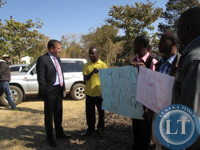 Germany Ambassador to Zambia  Bernd  Finke  to part of youths  who  had  displayed  placards  denouncing  homosexuality outside Kapiri mposhi court