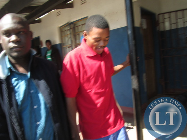 Acquitted James Mwape with a  relative outside court