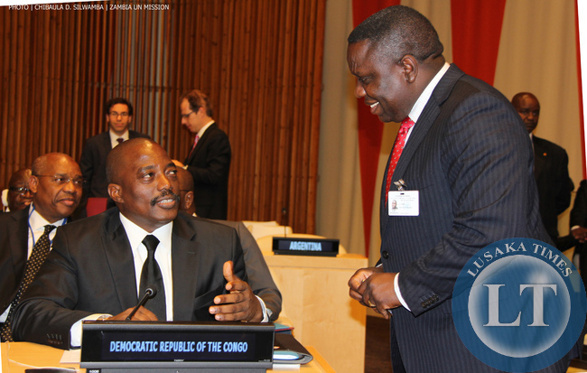 Zambia Foreign Minister Harry Kalaba (RIGHT) chats with Democratic Republic of Congo President Joseph Kabila at UN Headquarters on Monday 22-09-2014. PHOTO | CHIBAULA D. SILWAMBA | ZAMBIA UN MISSION