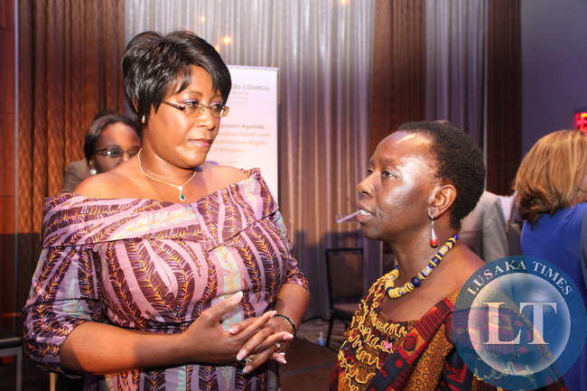 Former First Lady Dr Christine Kaseba -Sata  confers Musimbi Kanyoro after the Global Leaders Council discussion forum at Westin Hotel in New York on Sept 23,2014 -Picture by THOMAS