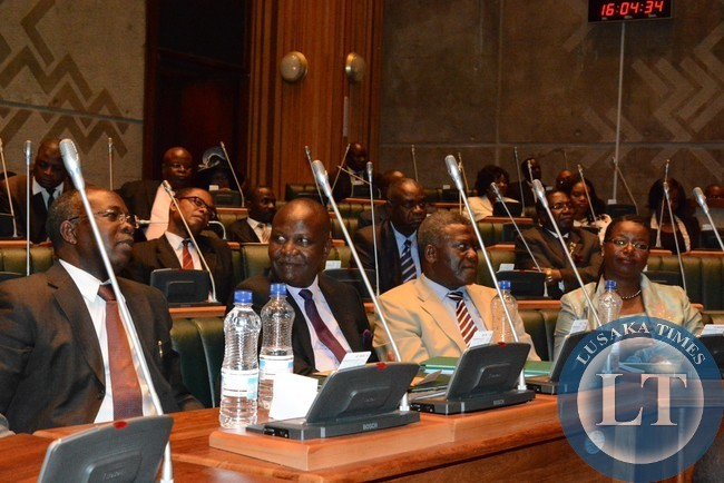 Opposition Members of parliament listens during the presentation of 2015 budget