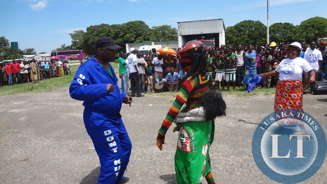 A jubilant MMD Die Hard National Youth Coordinator Bowman Lusambo dancing at Mongu airport