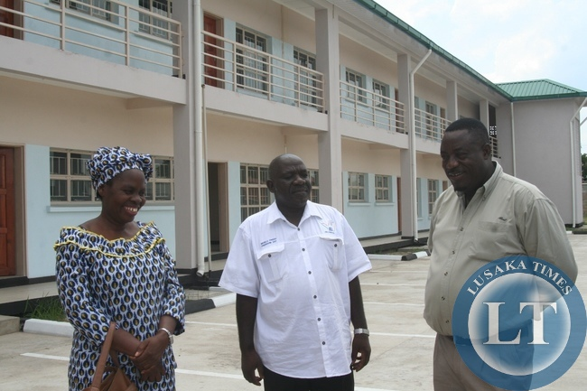 Cabinet Office Permanent Secretary for Special Duties Bert Mushala (c) flanked by Lewanika General Hospital Senior Environmental Officer ChilwanaJunist (r) and Mongu District acting Commissioner Alice Mutemwa (l) at the new Lewanika General Hospital Two Story Staff flats in Mongu District during the tour in Western Province to compile major developmental projects