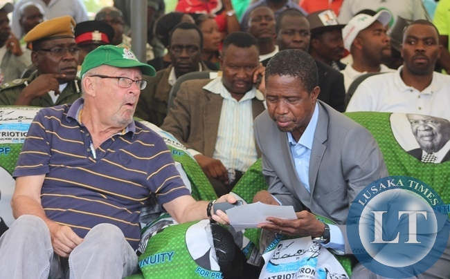 Acting President Guy Scott sharing notes with PF Presidential Candidate Edgar Lungu during the PF campaign Rally in Kabwe t
