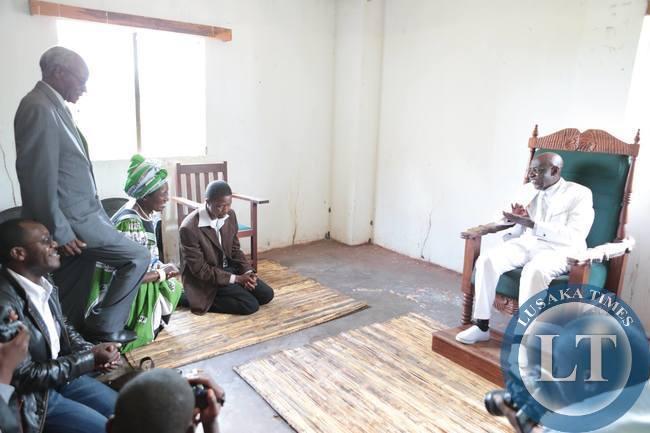 Edgar Lungu kneeling before Henry Sosala