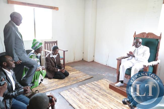 Edgar Lungu kneeling before Henry Sosala