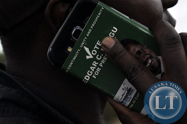 A PF cadre uses an Edgar Lungu branded device during the joint rally between Rupiah Banda and the PF presidential candidate in Chipata on Tuesday