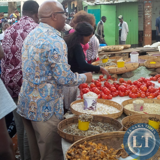 Dr Mumba offers to buy some items at Chilenje Market
