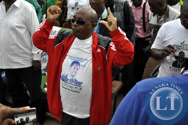 Education Minister John Phiri shows the MMD PF symbols during the Rupiah Banda and Edgar Lungu rally in Chipata