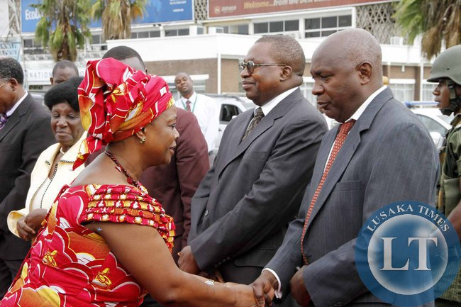 First Lady Esther Lungu greets senior Government officials  on arrival at Kenneth Kaunda International Airport shortly before departure to Addis Ababa, Ethiopia where she accompanied the President for the African Union Summit on January 29,2015 -Picture by THOMAS NSAMA