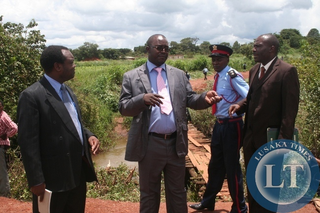 Newly appointed North Western province minister Dawson Kafwaya inspects the bridge 1