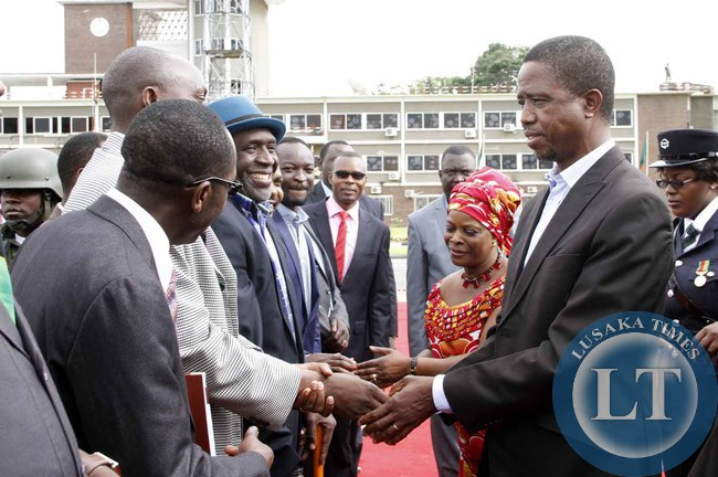 President Edgar Lungu greets Goodward Mulumbwa as his  Special Assistant for  Political Affairs Kaiza Zulu looks on  on arrival at Kenneth Kaunda International Airport shortly before departure to Addis Ababa, Ethiopia for the African Union Summit on January 29,2015 -Picture by THOMAS NSAMA