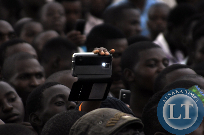 Some people who attended the joint rally for former president Rupiah Banda and Edgar Lungu using their mobiles phones to record pictures and videos of the event.