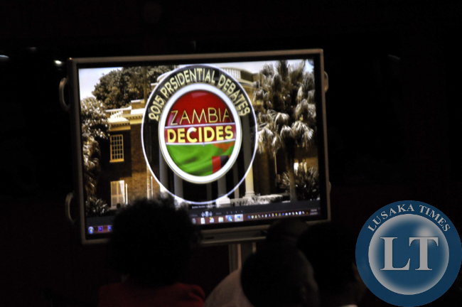 The logo for the presidential debates beams on a TV screen at Mulungushi international conference centre in Lusaka
