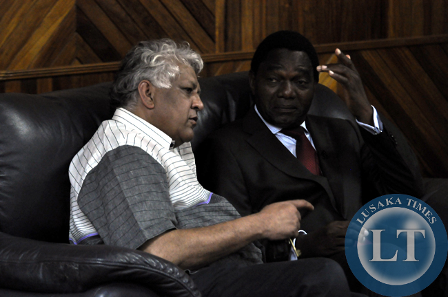 FILE: UPND campaign manager Depak Patel confers with party president Hakainde Hichilema