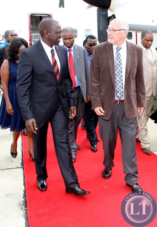 Kenya's Deputy-President William Ruto with Acting President of Zambia Dr Guy Scott on arrival at KK international Airport for the New Year's Eve Lunch with the Children of Kasisi Orphanage in Lusaka on December 31-2014 . The New Year's Eve State Lunch was hosted by Dr Scott at Kasisi in Lusaka