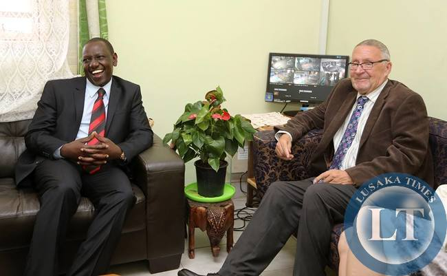 Deputy President of Kenya  Willian Ruto confers with  Acting President Guy Scott