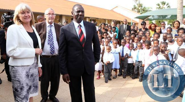 Acting President Dr Guy Scott with Visiting Kenya's Deputy President William Ruto took time off their busy schedules to have New Year's Eve Lunch with the Children of Kasisi Orphanage in Lusaka