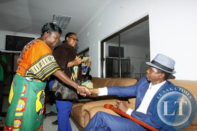 Patriotic Front (PF) President Edgar Chagwa Lungu (right) welcomes United Party for National Development (UPND) National Chairperson,Mutale Nalumango (left) at Simon Mwansa Kapwepwe International Airport in Ndola on Saturday,January 10,2015.PICTURE BY SALIM HENRY/SHENPA