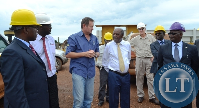 FISRT Quantum general manager Rudi Badenhorst (Third from left ) briefing Finance Minister Alexander Chikwanda (next) on the progress of the Trident Kalumbila mining Project in Solwezi when the visited the mine