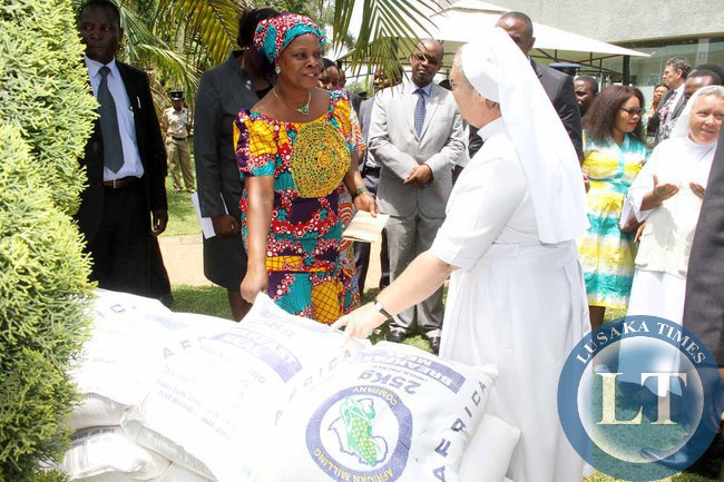 First Lady Esther Lungu  being congratulated by  Mother of Mercy Chilanga Hospice manager Sr Jeremia Mrowiec  after she donated food stuffs  to Mother of Mercy Chilanga Hospice  during the Launch of the Lafarge Foundation at Twangale Park in Chilanga District , Lusaka on February 19,2015 -Picture by THOMAS NSAMA