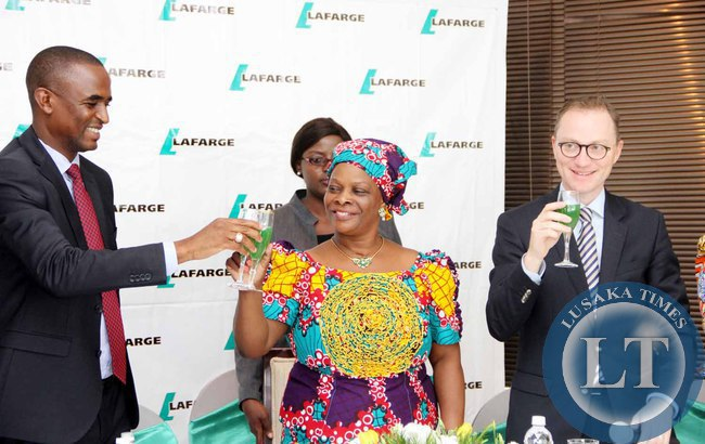 First Lady Esther Lungu toasts with Lafarge  Zambia Chief Executive officer Emmanuel Rigaux (r)  and Deputy minister of Justice Keith Mukata (l)  during the Launch of the Lafarge Foundation at Twangale Park in Chilanga, Lusaka on February 19,2015 -Picture by THOMAS NSAMA