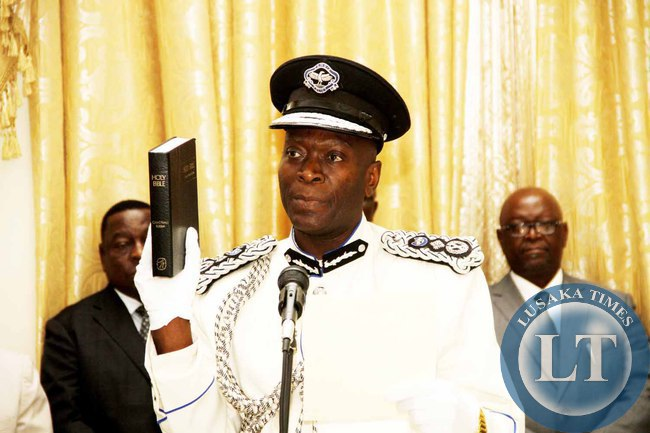 Inspector General of Police Kakoma Kanganja taking Oath during the swearing -in-Ceremony