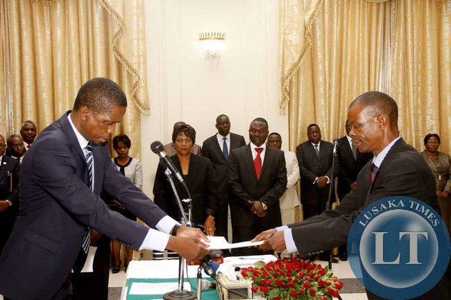 President Edgar Lungu receives an affidavit of Oath from Chiefs and Traditional affairs minister Dr Joseph Katema during the Swearing-In-Ceremony at State House on February 3,2015 -Picture by THOMAS NSAMA