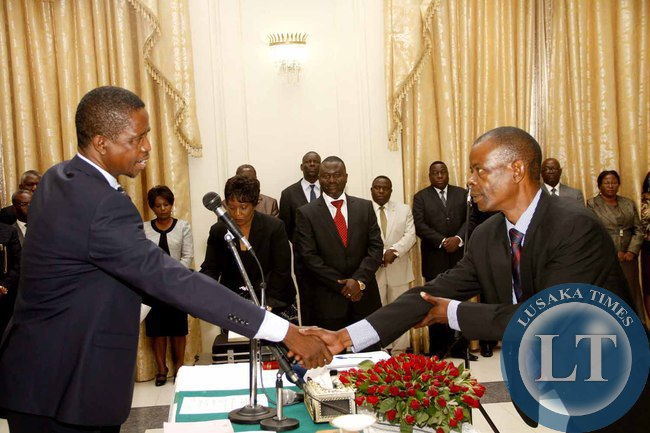 President Edgar Lungu congratulates Chiefs and Traditional Affairs minister Dr Joseph Katema (r)  during the Swearing-In-Ceremony at State House on February 3,2015 -Picture by THOMAS NSAMA
