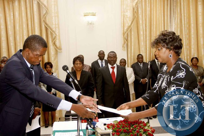 President Edgar Lungu receives an affidavit of Oath from  Commerce minister Margaret Mwanakatwe  during the swearing -in-Ceremony at State House on February  3,2015 -Picture by THOMAS NSAMA