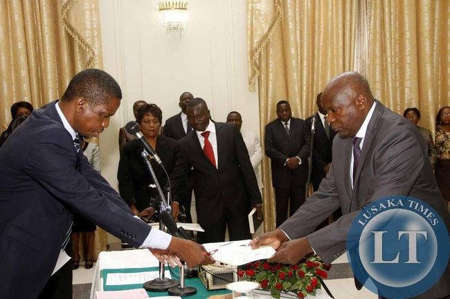 President Edgar Lungu receives an affidavit of Oath from Luapula Province Permanent Secretary Boniface Chimbwali  during the Swearing-In-Ceremony at State House on February 3,2015 -Picture by THOMAS NSAMA