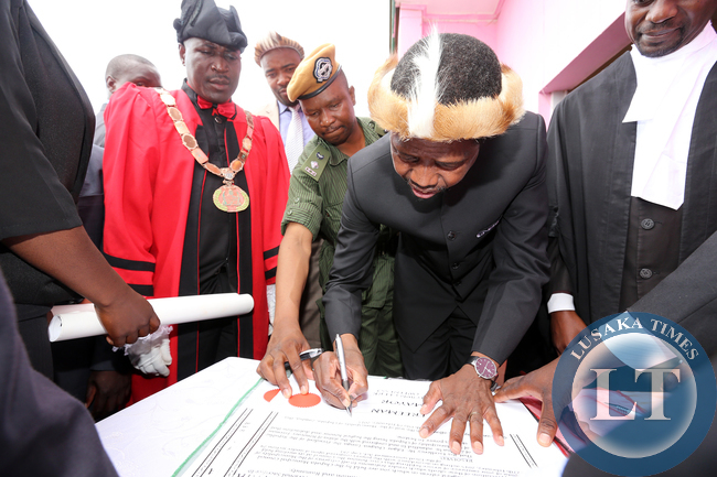President Edgar Lungu signs a Roll at Honourary Freeman of the Chipata Municipality at Civic Centre, Looking is town Clerk Davies Musenge and mayor Mr Jealous Phiri on Friday 27-02-2015. PICTURE BY EDDIE MWANALEZA/STATEHOUSE.