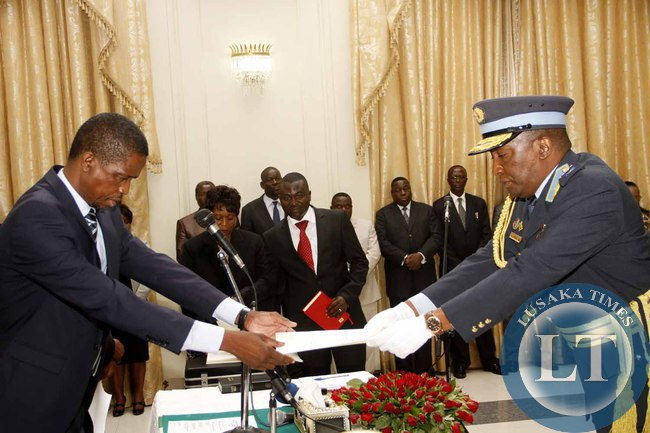 President Edgar Lungu receives an affidavit of Oath from Deputy ZAF Commander Maj Gen Muma during the swearing -in-Ceremony at State House on February  3,2015 -Picture by THOMAS NSAMA
