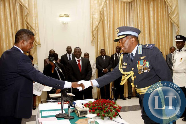 President Edgar Lungu congratulates  Deputy ZAF Commander Maj Gen Muma  during the swearing -in-Ceremony at State House on February  3,2015 -Picture by THOMAS NSAMA