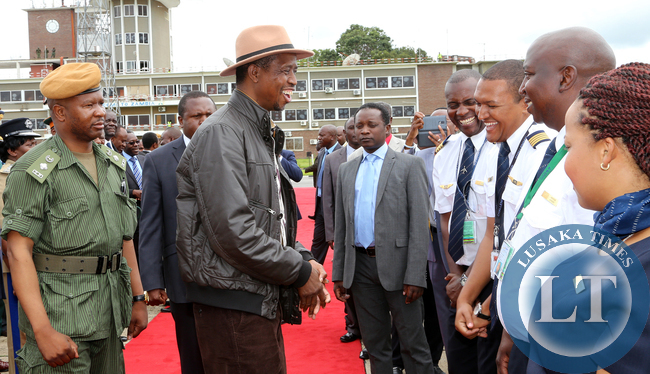 President Edgah Lungu share alight moment with pilots   at KK internatioanl airport in Lusaka Before he left for working Holiday in Mfuwe on 04-01-2015 PICTURE BY EDDIE MWANALEZA/STATEHOUSE.
