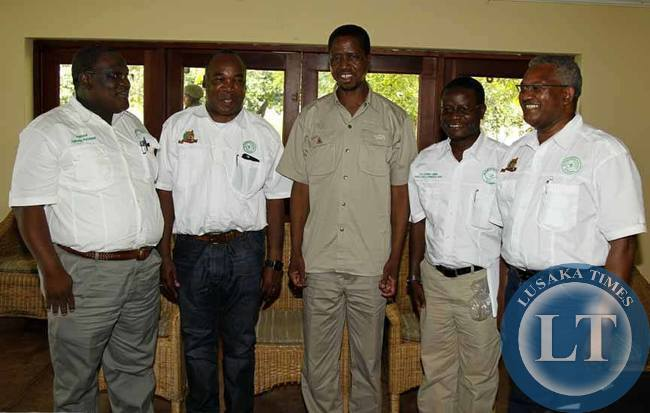 From Left to Right: George Sitali,Professor.Stephen Simukanga,President Edgar Chagwa Lungu and Professor Clive Chirwa at Chichele Presidential Lodge in Mfuwe on Thursday,February 5,2015. The Engineering Institution of Zambia (E.I.Z.) presented a National Transformation Strategy to indutrialise Zambia. PICTURE BY SALIM HENRY/STATE HOUSE