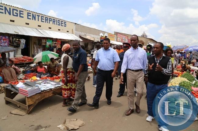 Lusaka Province Minister Obvious Mwaliteta with State house Deputy Minister Mulenga Sata tours the Lusaka city market