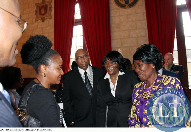 A Zambian national based in New York Cynthia Chirwa Lee congratulates Vice-President Inonge Wina after the latter's lecture at Columbia University on 11 March, 2015. PHOTO   CHIBAULA D. SILWAMBA   ZAMBIA UN MISSION
