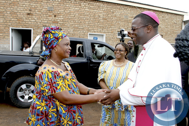 First Lady Esther Lungu  being welcomed by  Diocese of Mansa Bishop Patrick Chisanga when she paid a courtesy call on him at his offices in Luapula Province  on February 28,2015. This was during First Lady's Outreach Programme for People with Special Needs -Picture by THOMAS NSAMA