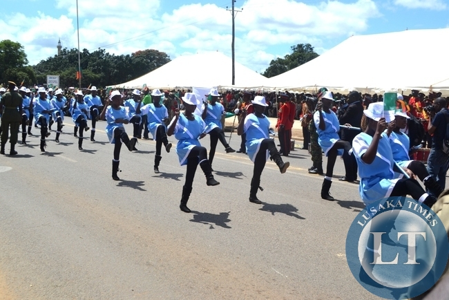 Matero Girls Majorettes add colour during a match-pass to commemorate youths day  at the at the  freedom statue in Lusaka