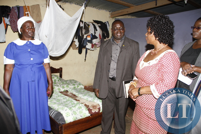 First Lady Esther Lungu tours  Mansa SDA Orphanage as the orphanage Coordinator  Webby Kalipenta  looks on in Luapula Province