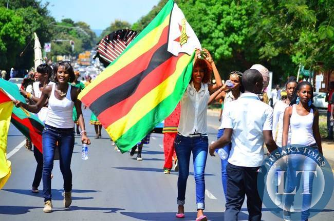 The dance group from Zimbabwe raise the flag high during the flagging off of LICAF2015