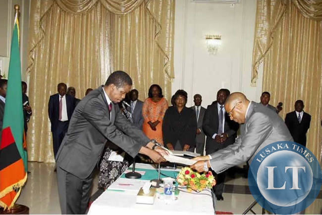 President Lungu receives the oath of office affidavit from Bank of Zambia governor Dennis Kalyalya during the swearing in ceremony at State house on Wednesday 18th March .Picture by Salim Henry State house