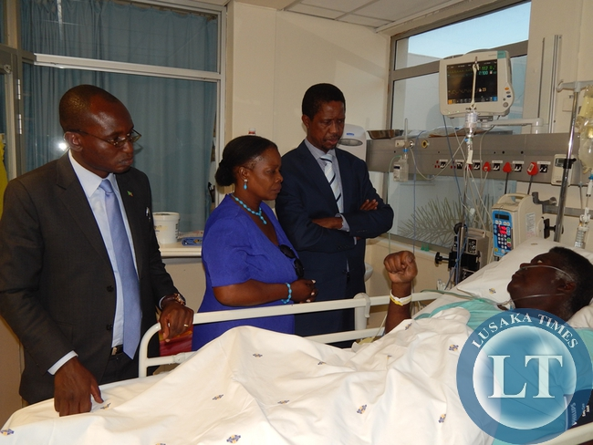 President Lungu with First Lady, Mrs. Esther Lungu and Special Assistant to the President for Press & PR, Mr. Amos Chanda at Mr. Willie Nsanda's bedside