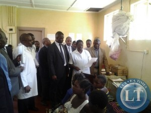 Parliamentary committee on health talking to nurse incharge at mothers shelter at Chipata General Hospital on Thursday as expectant mothers looking