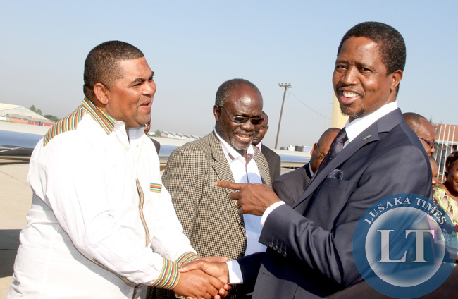FILE: President Edgar Lungu with Lusaka Province minister Mwaliteta at Harare International Airport  shortly before departure  for Bulawayo where he will officially open the Zimbabwe Trade Fair on April 30,2015 -Picture by THOMAS NSAMA