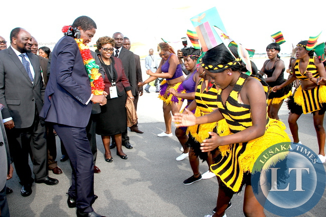 President Edgar Chagwa Lungu join Traditional dancers upon arrival at Harare International Airport for SADC Summit on April 28,2015 -Picture by THOMAS NSAMA